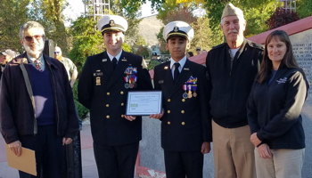 Photograph of NJROTC cadets getting award